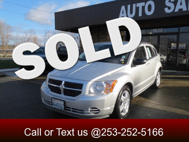 2009 Dodge Caliber SXT This gently used 2009 Dodge Caliber is a versatile five-door compact vehicle