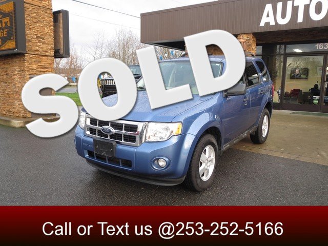 2009 Ford Escape XLT 4WD The CARFAX Buy Back Guarantee that comes with this vehicle means that you