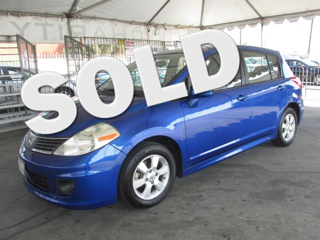 2009 Nissan Versa 18 SL Please call or e-mail to check availability All of our vehicles are av