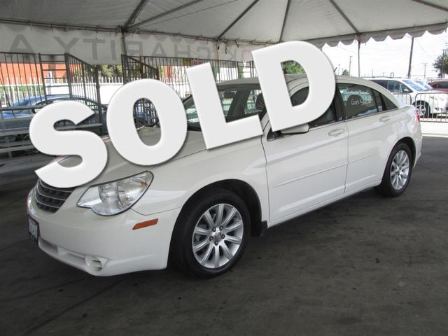 2010 Chrysler Sebring Limited Please call or e-mail to check availability All of our vehicles a