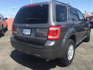 2010 Ford Escape XLT AUTOWORLD (702) 452-8488 Las Vegas, Nevada 3