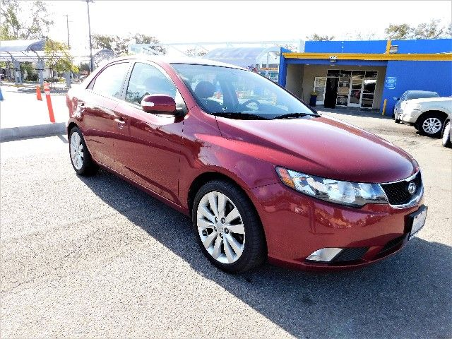 2010 Kia Forte SX Limited warranty included to assure your worry-free purchase AutoCheck report i