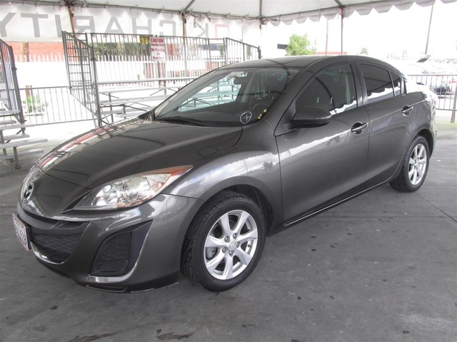 2010 Mazda Mazda3 i Touring Please call or e-mail to check availability All of our vehicles are