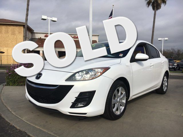 2010 Mazda Mazda3 i Youll love this gas sipping vehicle when you fill up at the pump VIN JM1BL