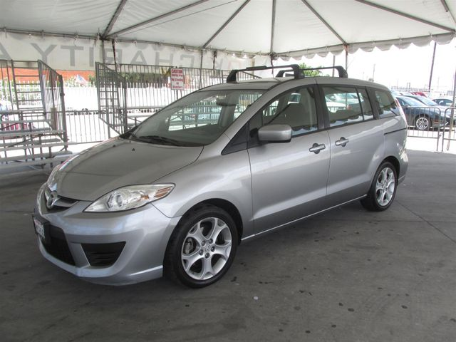 2010 Mazda Mazda5 Sport Please call or e-mail to check availability All of our vehicles are ava