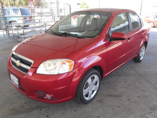 2011 Chevrolet Aveo LT w2LT Please call or e-mail to check availability All of our vehicles ar