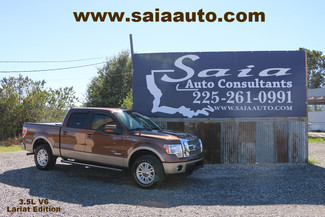 2011 Ford F 150 Lariat 4wd Supercrew Leveled Duller A/Ts Bed Cover NO FLOOD One Owner Clean Car Fax | Baton Rouge , Louisiana | Saia Auto Consultants LLC-[ 2 ]