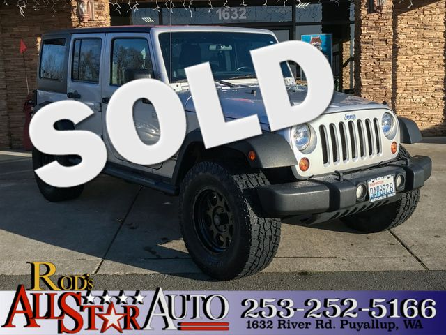 2011 Jeep Wrangler Unlimited 4WD The CARFAX Buy Back Guarantee that comes with this vehicle means