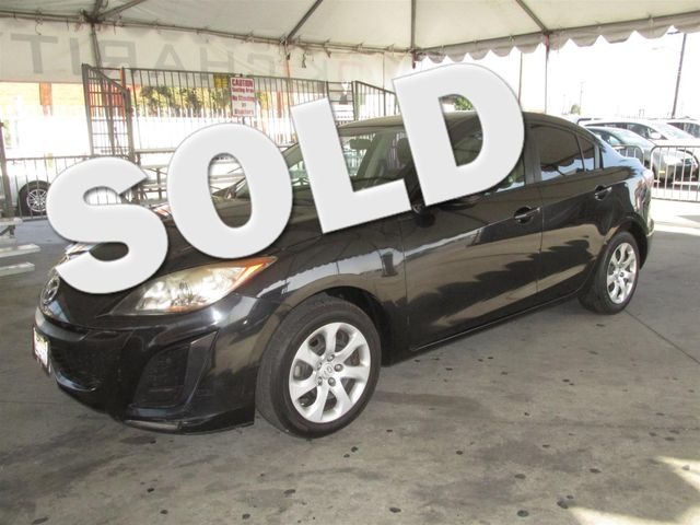 2011 Mazda Mazda3 i Sport Please call or e-mail to check availability All of our vehicles are a