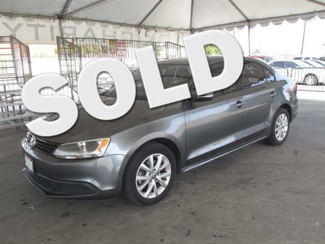 2011 Volkswagen Jetta SE wConvenience  This particular vehicle has a SALVAGE title Please call