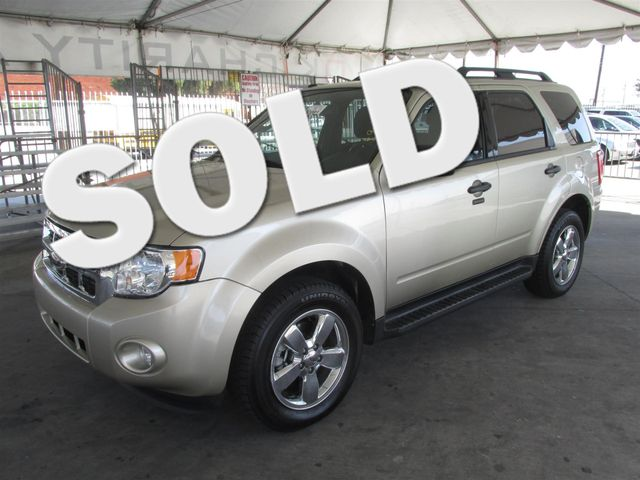 2012 Ford Escape XLT This particular vehicle has a SALVAGE title Please call or email to check av