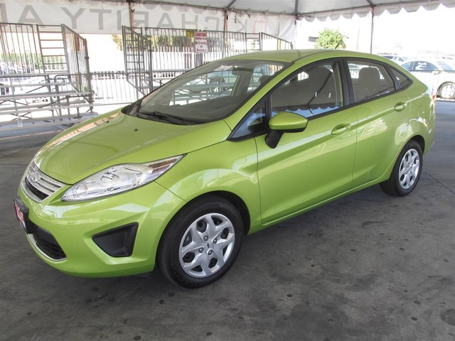 2012 Ford Fiesta SE This particular vehicle has a SALVAGE title Please call or email to check ava