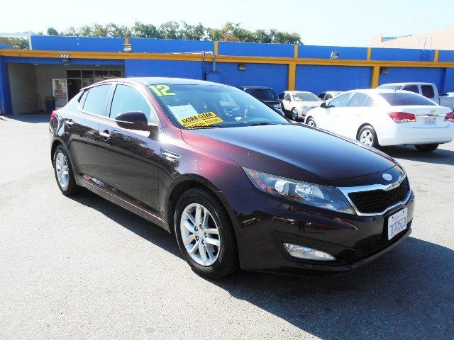 2012 Kia Optima LX Limited warranty included to assure your worry-free purchase AutoCheck report