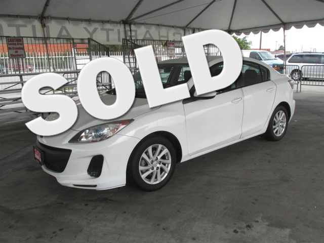 2012 Mazda Mazda3 i Touring Please call or e-mail to check availability All of our vehicles are
