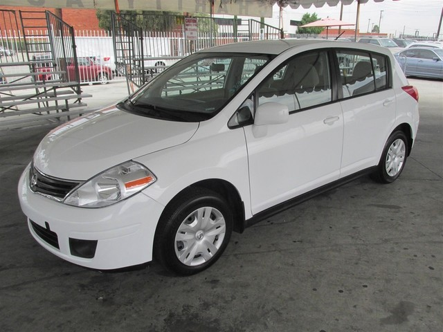 2012 Nissan Versa S This particular vehicle has a SALVAGE title Please call or email to check ava