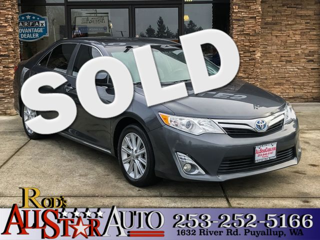 2012 Toyota Camry Hybrid XLE This vehicle is a CarFax certified one-owner used car Pre-owned vehi