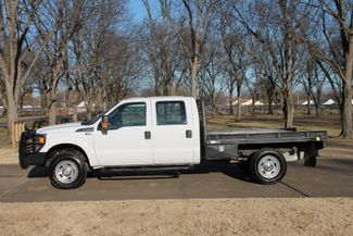 2013 Ford F-350 Crew Cab 4WD  wFlat Bed WHay Bale Lift price - Used Cars Memphis - Hallum Motors citystatezip  in Marion, Arkansas