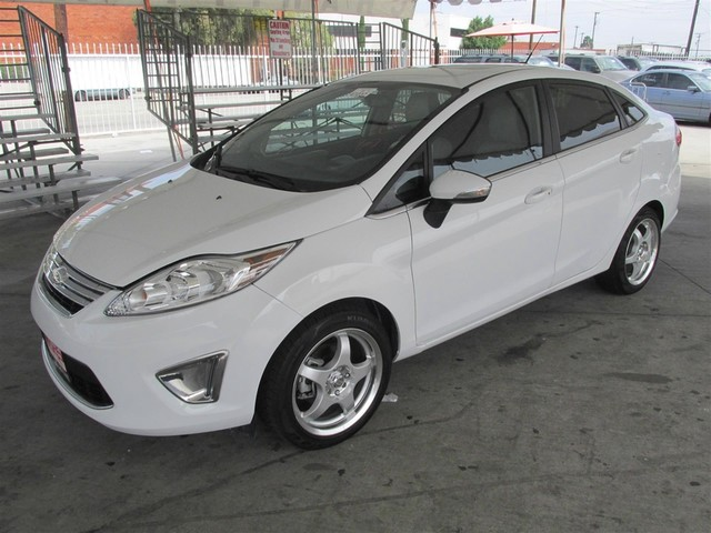2013 Ford Fiesta Titanium This particular vehicle has a SALVAGE title Please call or email to che