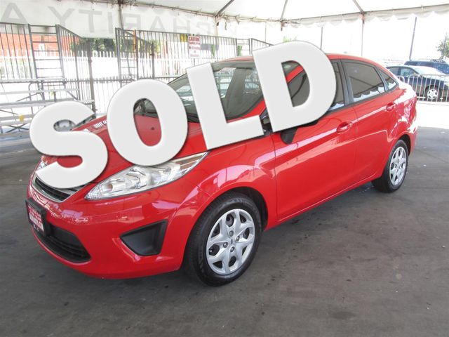 2013 Ford Fiesta SE This particular vehicle has a SALVAGE title Please call or email to check ava