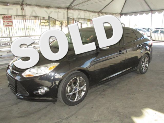 2013 Ford Focus SE Please call or e-mail to check availability All of our vehicles are availabl