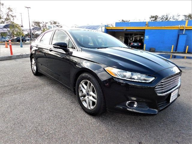 2013 Ford Fusion SE Limited warranty included to assure your worry-free purchase AutoCheck report