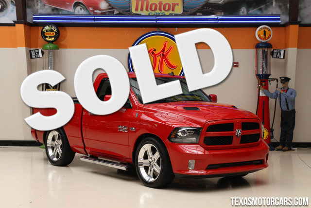 2013 Ram 1500 RT The 2013 Ram 1500 RT is a sporty regular cab short bed pickup with a 395-hp 57