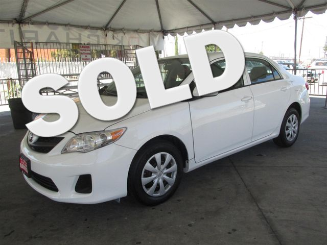 2013 Toyota Corolla LE This particular vehicle has a SALVAGE title Please call or email to check