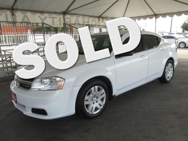 2014 Dodge Avenger SE Please call or e-mail to check availability All of our vehicles are avail