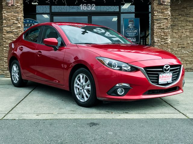 2014 Mazda Mazda3 i Touring The CARFAX Buy Back Guarantee that comes with this vehicle means that