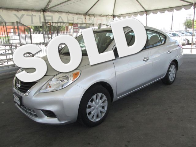 2014 Nissan Versa SV This particular vehicle has a SALVAGE title Please call or email to check av