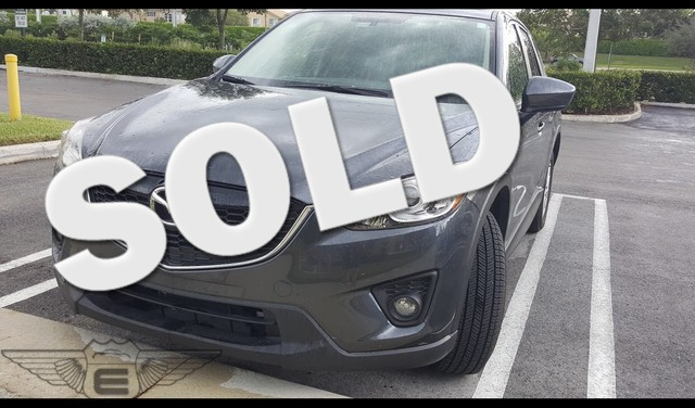 2015 Mazda CX-5 Touring This Mazda Cx-5 Touring with ONLY 10 125 miles is like NEW Meteor Gray e